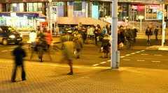 Pedestrians crossroads. Smooth blurred motion in the night city. Timelapse shot. Stock Footage