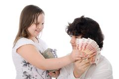 Girl wants to take away money from boy Stock Photos