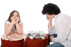 guy with girl consider a lot of money - stock photo