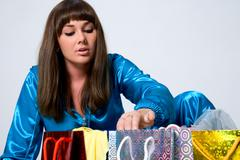 The girl looks in packages - stock photo
