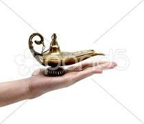 Holding a Magic Lamp Stock Photos