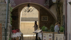View of people at a beautiful outdoor restaurant in Dubrovnik, Croatia Stock Footage