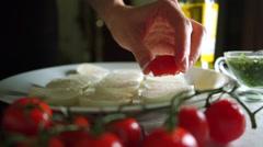 Making mozzarella and tomato salad (Caprese). Part of the set Stock Footage