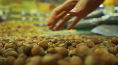 Handful of hazelnuts in a supermarket, slow motion video Stock Footage