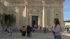 Stock Video Footage of View of people in front of Jesuit Church of St Ignatius in Dubrovnik, Croatia
