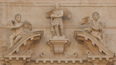 Sculptures of angels above the entrance of Church of Saint Blaise in Dubrovnik Stock Footage