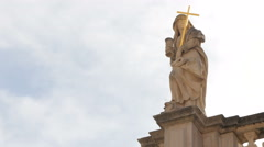 Sculpture of an angel holding cross atop the Church of Saint Blaise in Dubrovnik Stock Footage