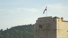 Stock Video Footage of Croatian waving flag on the City Walls of Dubrovnik, Croatia