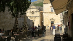 View of an outdoor restaurant near Saint Saviour Church in Dubrovnik, Croatia Stock Footage