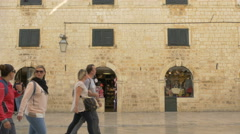 People walking in Luza square near stores in Dubrovnik, Croatia Stock Footage