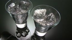 POURING WATER INTO TWO GLASSES - stock footage
