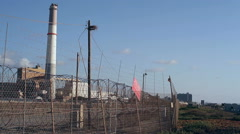 Small airplane jet lands in Tel-Aviv airport, power station, Israel - stock footage