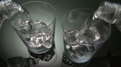 POURING WATER INTO TWO GLASSES Stock Footage