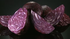 RED CABBAGE  BEING PREPARED  ON A KITCHEN WORKTOP Stock Footage