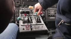 Cockpit inside. Hands pilots run gadgets of seaplane. Video with sound Stock Footage