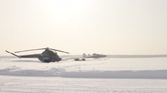 Helicopter pilot prepares his vehicle for take-off Stock Footage