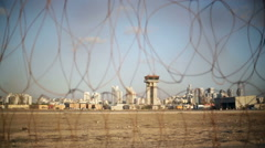 Airport control tower, focus pull to barbed wire security fence, shallow DOF Stock Footage