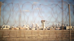 Airport control tower, focus pull to barbed wire electric motion security fence - stock footage