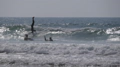 pro surfer ride on head, morocco - stock footage