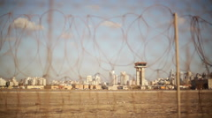 Airport control tower, focus pull to barbed wire electric motion security fence Stock Footage