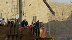 Stock Video Footage of People in a wooden ship and a man waving the Croatian flag in Dubrovnik, Croatia