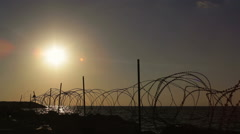 Barbed wire security border fence, no entry from sea, sunset Stock Footage