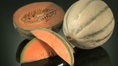 CANTALOUPE MELON  BEING PREPARED  ON A KITCHEN WORKTOP Stock Footage