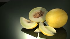 GALIA MELON  BEING PREPARED  ON A KITCHEN WORKTOP Stock Footage