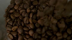 Coffee beans are being filled in coffee grinder in slow motion Stock Footage