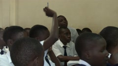 African students talking to teacher raising hand to answer a question-Edu Africa Stock Footage