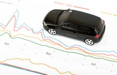 Black car on graphical charts - stock photo