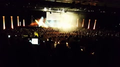 Crowd of people in a concert hall -Lights and smoke -singing and dancing - stage Stock Footage