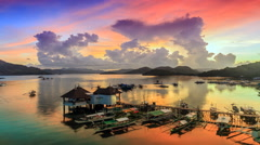 Sunset over Coron harbour timelapse - stock footage