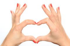 Woman making a heart gesture Stock Photos