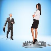 Businessman with lady in bear trap Stock Photos