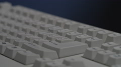 Man typing on keyboard close up Stock Footage