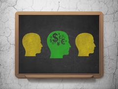 Stock Illustration of Finance concept: head with finance symbol icon on School Board background