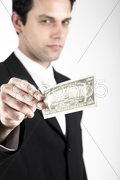 Business Man Offering One Million Dollars - stock photo