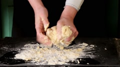 Female hands making dough for pasta over black table Stock Footage