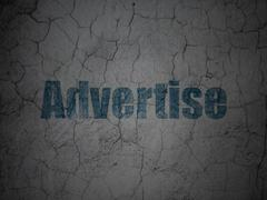 Advertising concept: Advertise on grunge wall background Stock Illustration