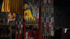Buddhist monks on the background of the Buddha statue Stock Footage