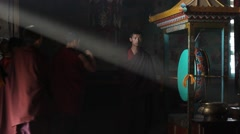 Monks enter the monastery and pray at the entrance - stock footage