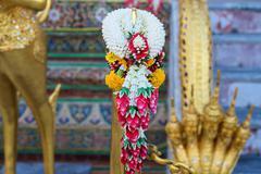 garland to worship Buddha statue - stock photo