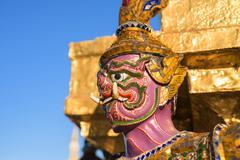 Demon Guardian at Wat Phra Kaew in Bangkok Kuvituskuvat