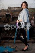 Fashion shot in auto repair shop. - stock photo