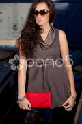 Fashion shot in auto repair shop. Stock Photos