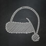 Stock Illustration of Holiday concept: Christmas Hat on chalkboard background