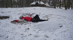 Man is Lying on a Snow With His Hands Under Head His Leg Pursed Happy Man Slow Stock Footage