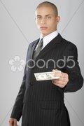 Good Looking Businessman on Gray - stock photo