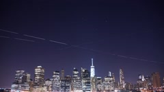 Star, Airplane, and Aviation trails above New York City - stock footage